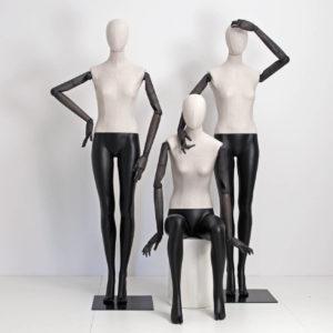 Vintage mannequin med stof og bevægelige arme og hænder.