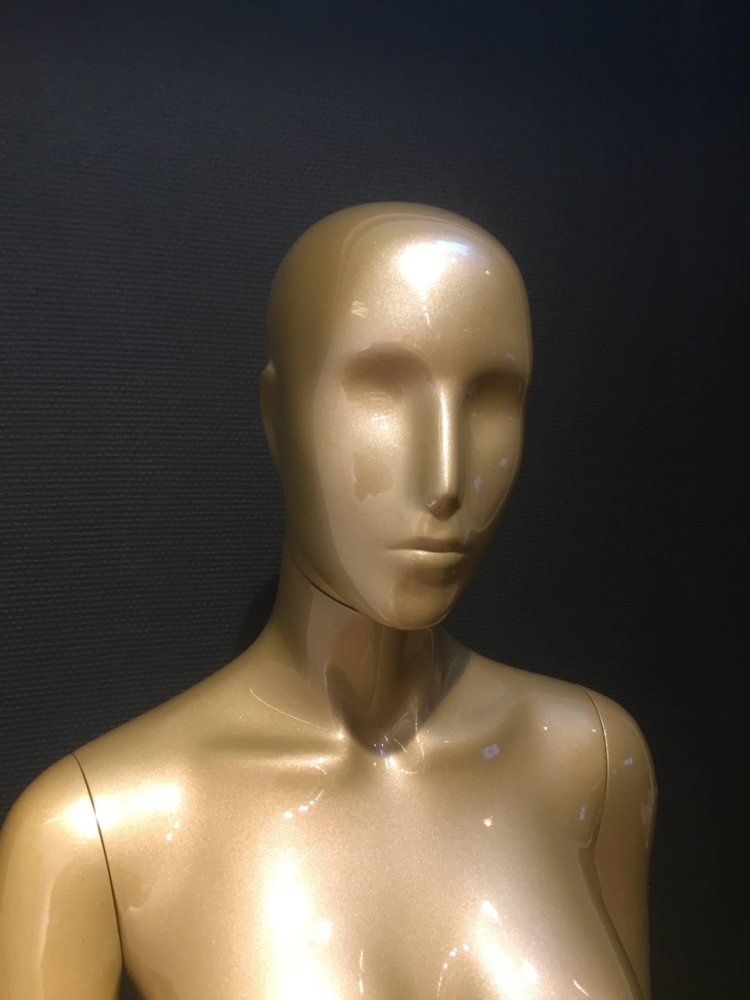 Gold mannequins - gold torsoes.