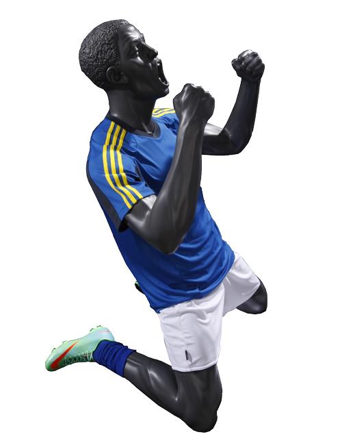 Fodbold spiller jubler over scoring. Sportsmannequin